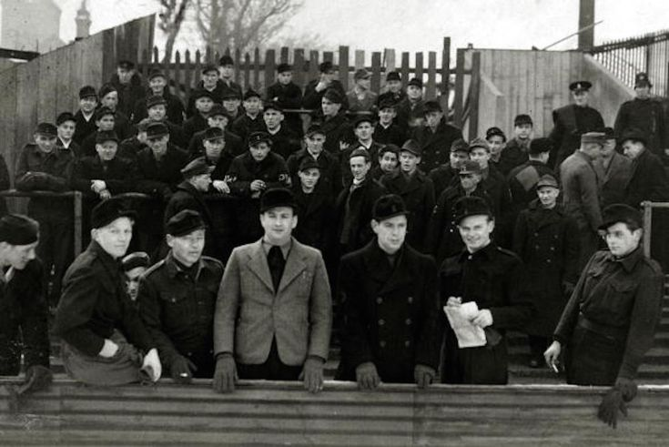 circa 1946, London, German prisoners enjoying a day out at Upton Park to watch West Ham United play Bradford, the men allowed out because of their good behaviour (Photo by Popperfoto/Getty Images)
