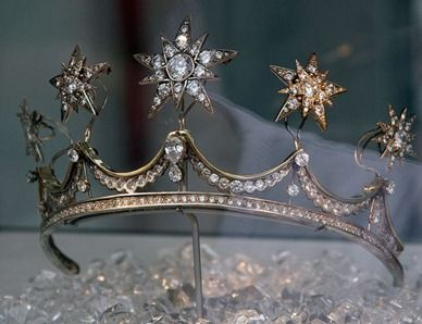 Princess Maxima's (Dutch) Wedding Tiara  in 1879. Diamond stars were quite in fashion then. Empress Elisabeth (Sissi) of Austria-Hungary had started wearing diamond stars (made by her Viennese Court Jeweller) in her hair a few years earlier and that had sparked quite a rage among royal ladies to wear diamond star jewellery. It's likely that the stars were purchased in Vienna.