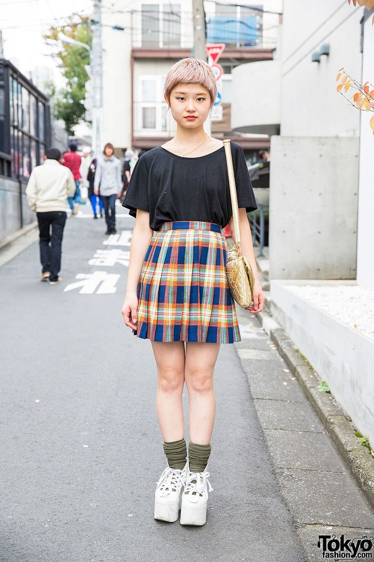 20-year-old hair salon assistant Ayano on the street in Harajuku with a cute short pastel hairstyle, a Uniqlo t-shirt tucked into a resale skirt, and Tokyo Bopper platforms.