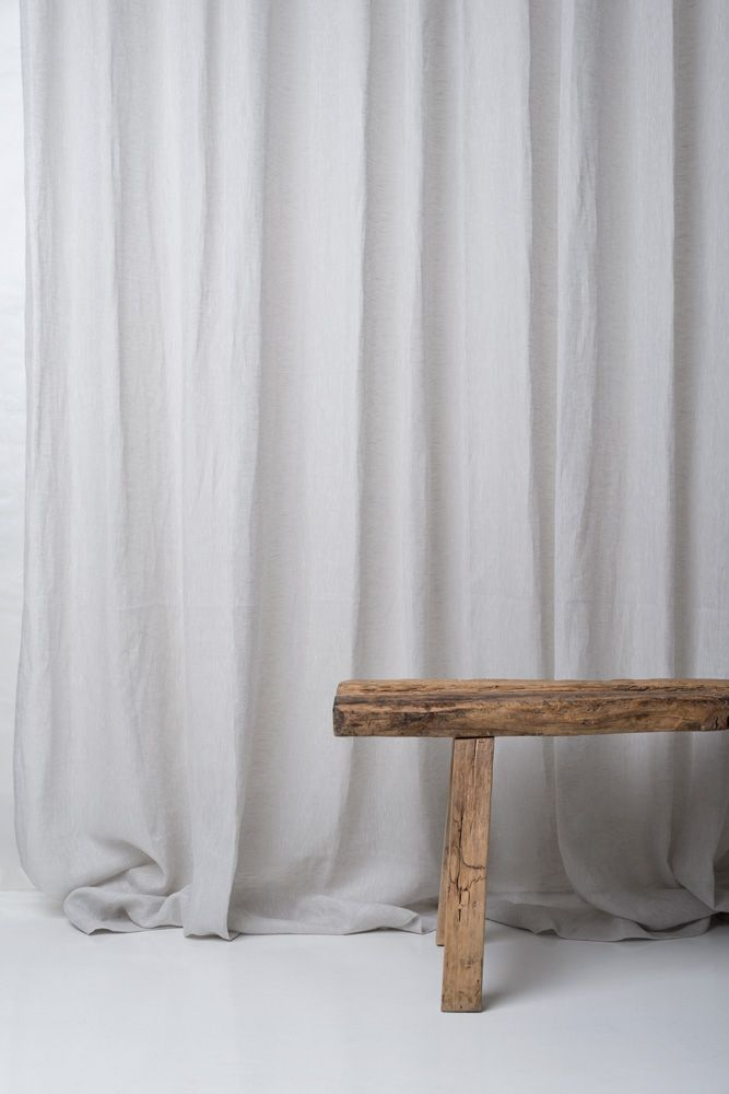 Curtains in linen fabric Venere from Astrid and a wooden bench.