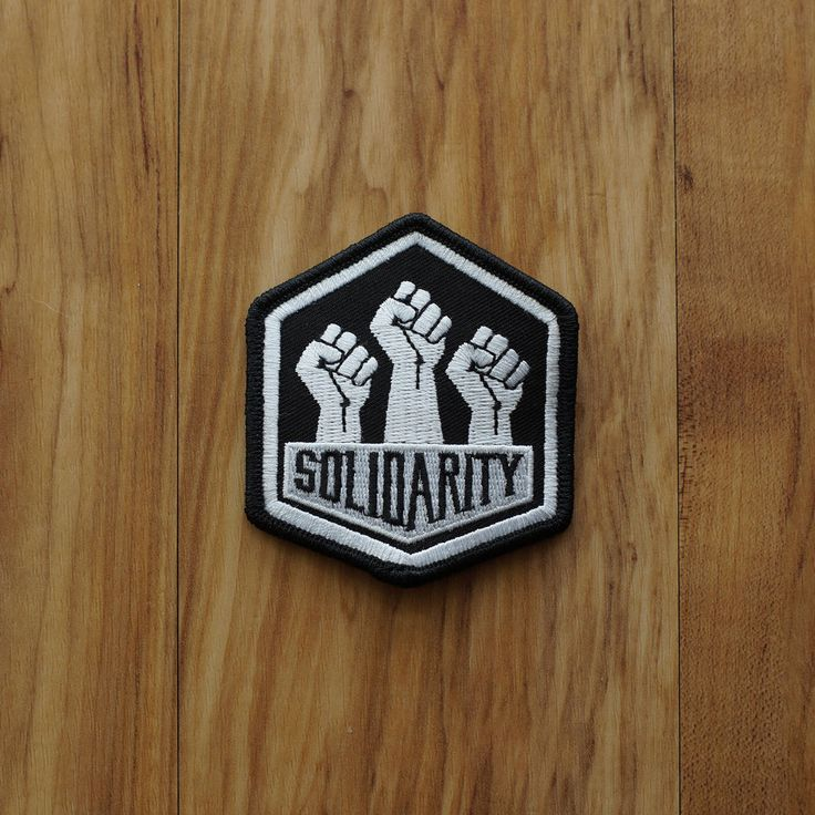 FREE SHIPPING WITHIN THE UNITED STATES ----  Solidarity Embroidered Patch 3 inches tall by 2.6 inches wide. Solidarity means to be in agreement through unity and action.  Our commitment to solidarity is to stand with our communities targeted by a political agenda run on hate, fear, and racism. Together we are stronger, united we are powerful, and through solidarity, we can overcome hate.  Orders are sent in a letter size envelope with stamps, so it will be in your mailbox. Since we are…