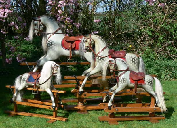 Classic Large Rocking Horse, Medium and Small Ayres, and Small Collinson restored antique rocking horses enjoying the sunshine in the North Yorkshire garden by Classic Rocking Horses