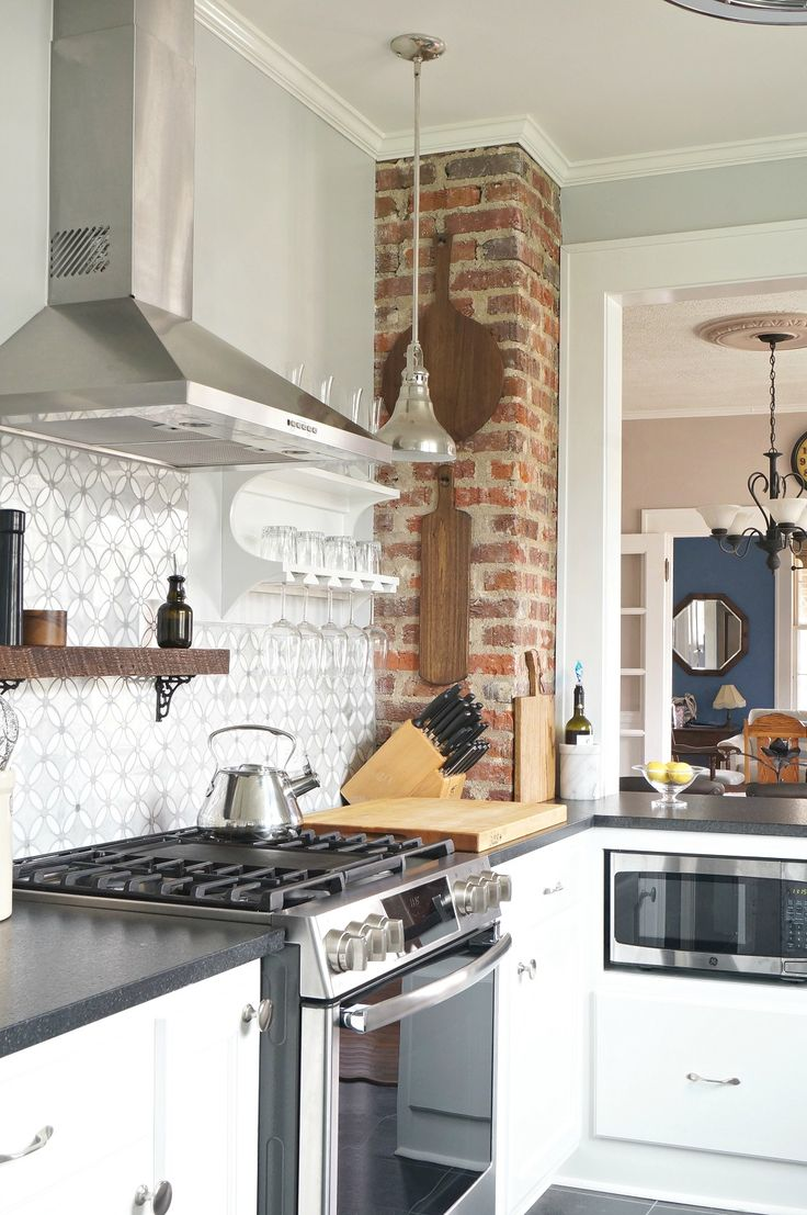 1930's Vintage kitchen update with exposed brick, white ...