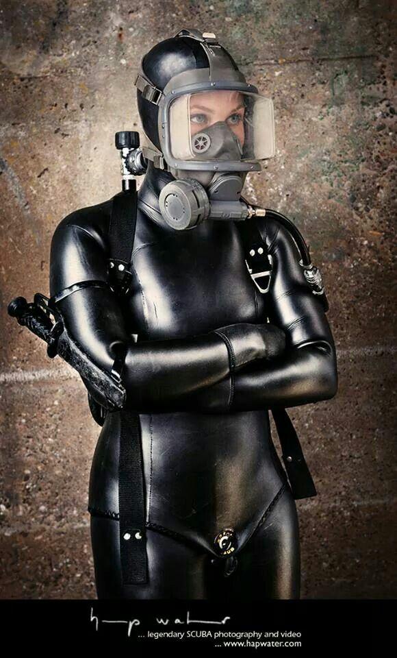 Woman In Black Scuba Suit Heavy Rubber Diving Gear In