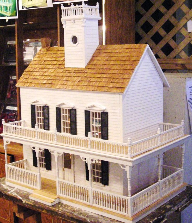 Farmhouse With Square Tower And Wrap-Around Porch From