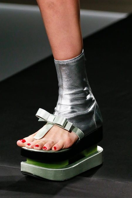 I think I've pinned this one before, but the awfulness continues to amaze.  [Prada SS 2013]