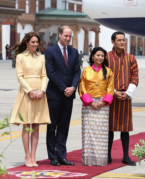 (2L) Prince William, Duke of Cambridge and Catherine, Duchess of Cambridge(L), King of Bhutan's sister Chhimi Yangzom and her husband at the Paro International Airport for the first day of a two day visit to Bhutan on April 14, 2016 in Paro, Bhutan.