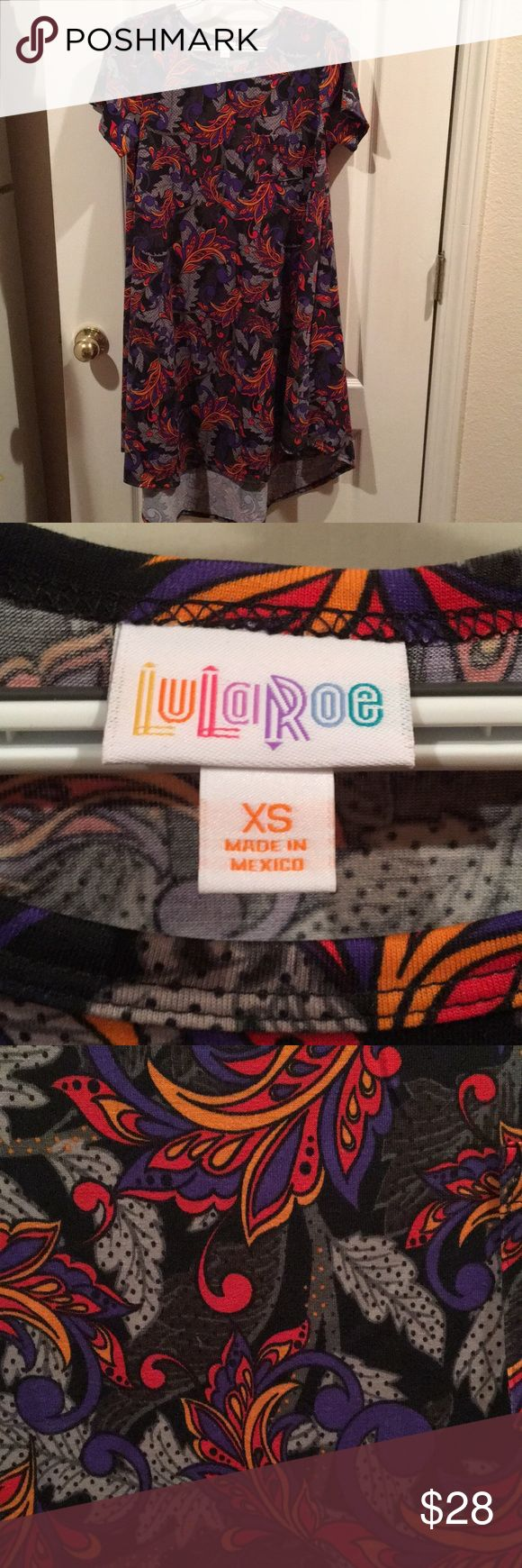 Lularoe Carly Dress-XS This Carly has been worn maybe twice but is in excellent condition. Carly size XS fits size 2-4 but I wear 4-6 and it fits perfect. Make me an offer or bundle to save! LuLaRoe Dresses High Low
