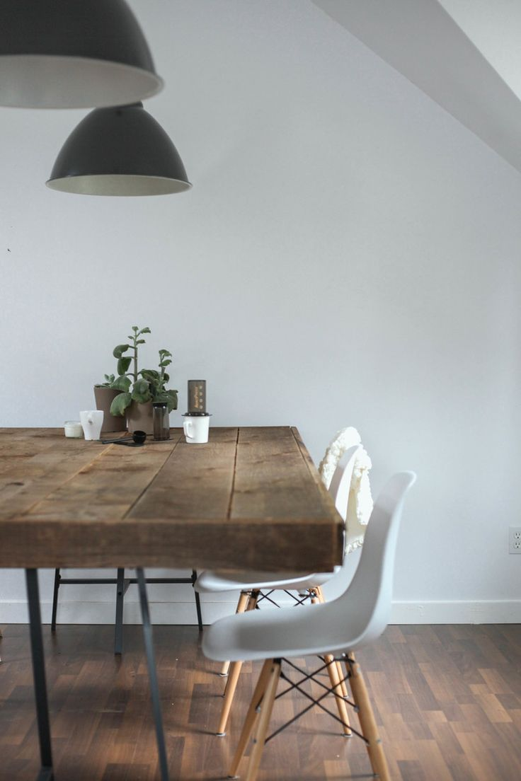 Dining area: again wooden table works with wooden floor and white Eames chairs with wooden legs.