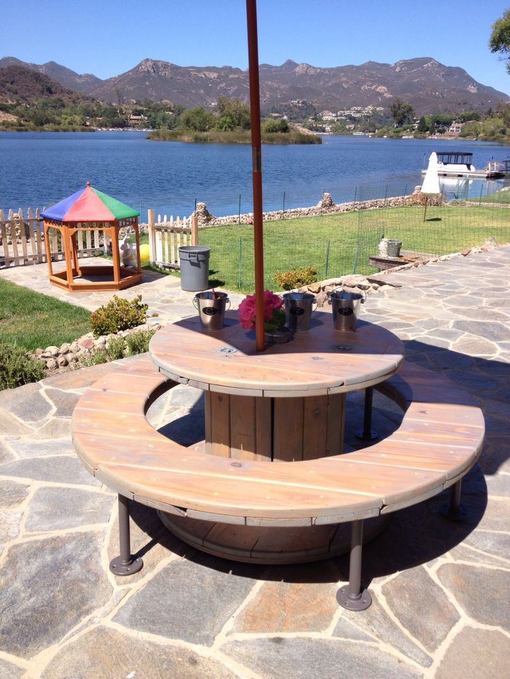 Children's picnic table made from re-purposed wire spools, stained grey using VOC free milk paint and sealed with tung oil