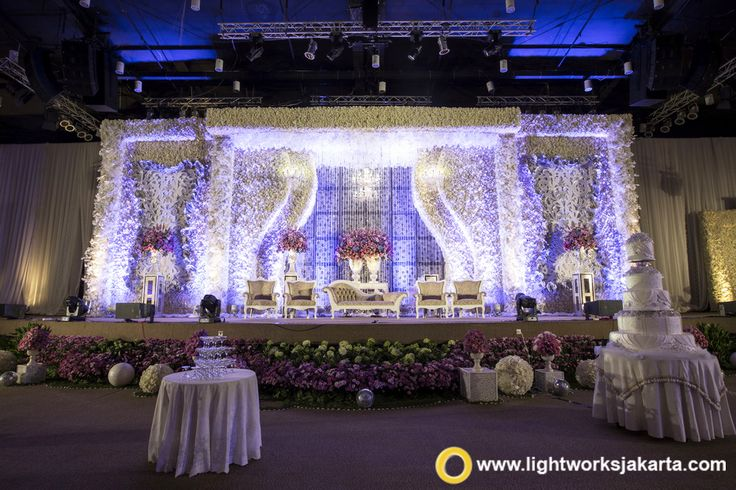 The beauty of Hadi and Henny's wedding stage made by Grasida Decoration with Lightworks as the lighting designer