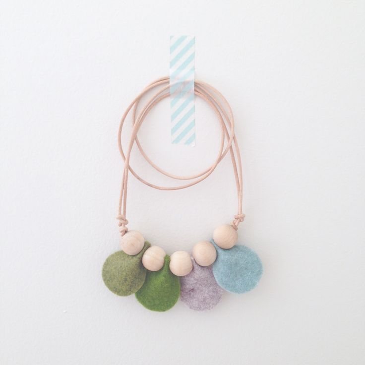 """•""""Petal"""" Necklace • Dear May •    Felt petals and wooden beads on adjustable leather cord, fits adults and little ones. Mum and bub can share!"""