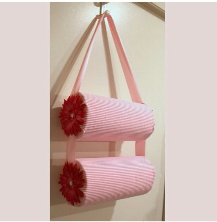 To display Mickey ears or put headbands, two oatmeal cans wrapped in fabric with hot glued ribbon to hang