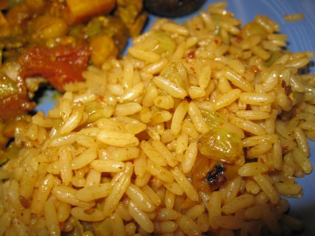 Moroccan Rice Pilaf.  This is delicious!! 1 teaspoon butter, 1/2 cup chopped onion, 1 tsp paprika, 1 tsp cumin, 1/2 tsp cayenne pepper, 1 cup white basmati rice, 1 1/2 cups water or vegetable stock, black pepper to taste, 1/4 cup sliced almonds, 1/4 cup raisins. Preheat oven to 350°F. Cook onions for 3-4 min in butter until translucent. Add spices and rice and cook for 3-4 minutes. Add stock and raisins. Boil, then cook in the oven for 18 minutes. Fold in salt, pepper and almonds.