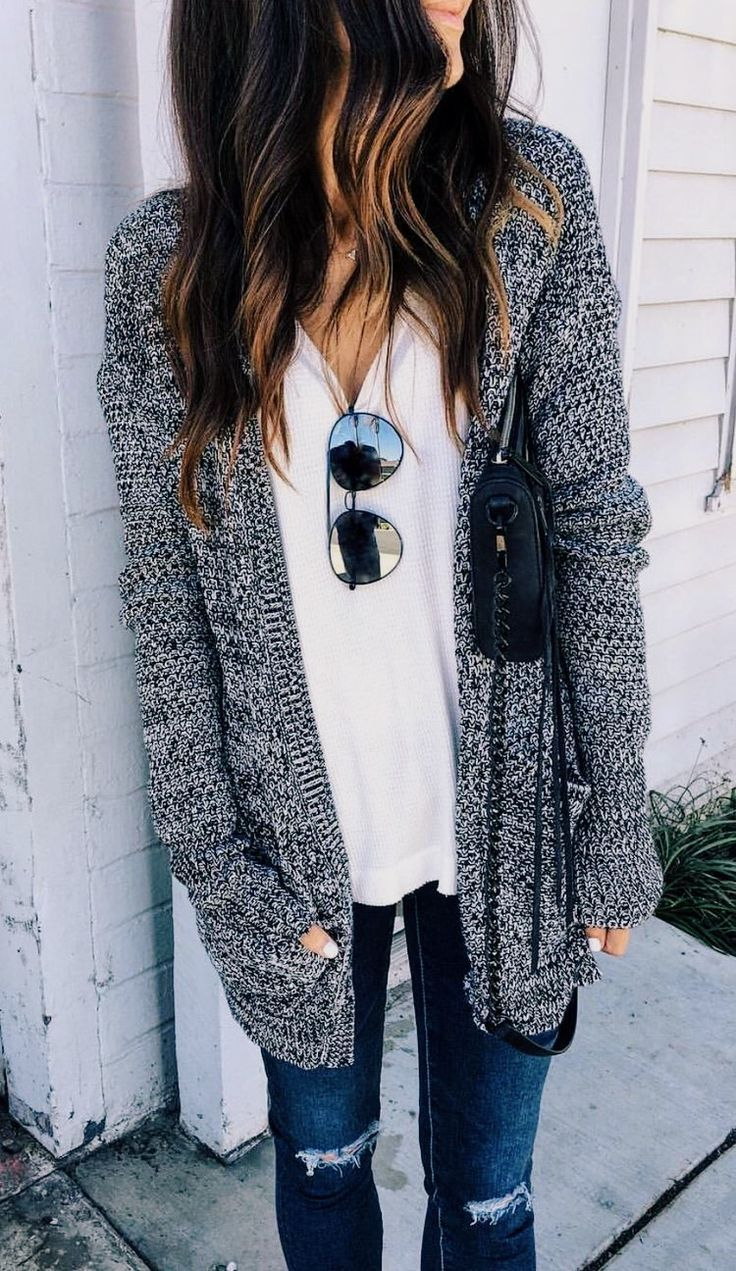 long gray knit sweater with a white tee