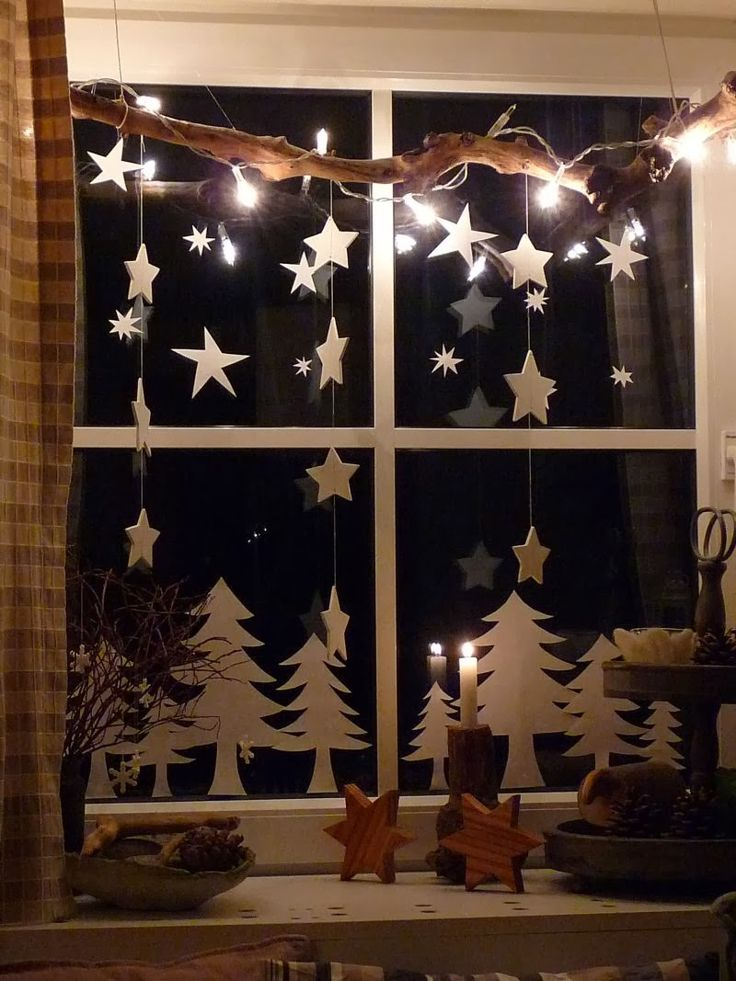 Paper cut Christmas window/mirror decorations … could also use shiny metallic foil papers, such as green for trees and silver/gold for the stars …