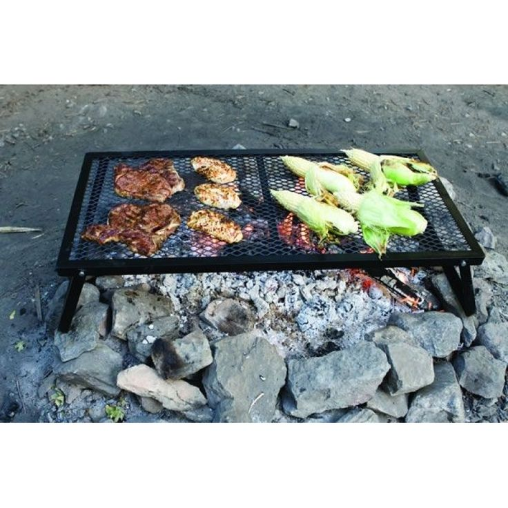 """Portable, simple, and ready to go. The """"minimalists' heavy-duty stove"""" will have you cooking naturally over a fire in no time. Prepare a nice bed of coals, set the Lumberjack Over Fire Grill on top and you can cook steaks, chicken, or burgers directly over the fire. Or use a..."""