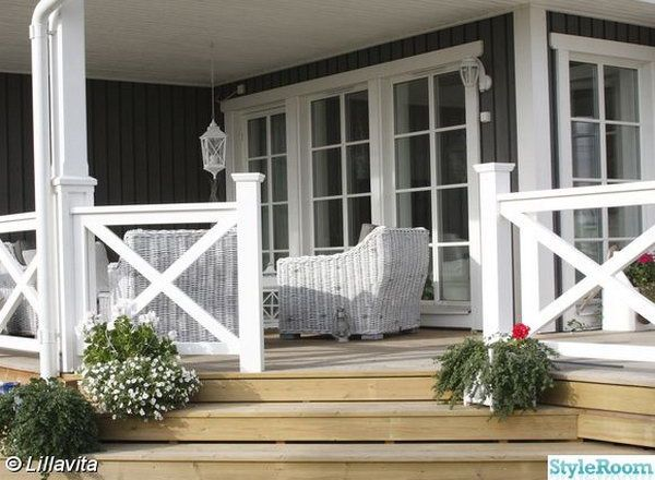 Natural color deck and the white X shape railing. Stylish X shape decorations become more and more popular these days. Awesome white X shape rails add to a delicate custom look to the natural color deck.