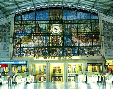 Bilbao's Abando Train Station: Basque Country, Spain, Europe: A beautiful stained-glass mural overlooks the main hall of Bilbao's Abando train station.