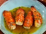 Star Jones' Garlic Lobster Tails  Ingredients  4 large lobster tails (8 ounces each)  4 to 6 large cloves garlic, minced  6 tablespoons butter, cut into bits  1 lemon, juiced  1/2 teaspoon Cajun spice  1/2 teaspoon seafood seasoning, such as Seafood Magic