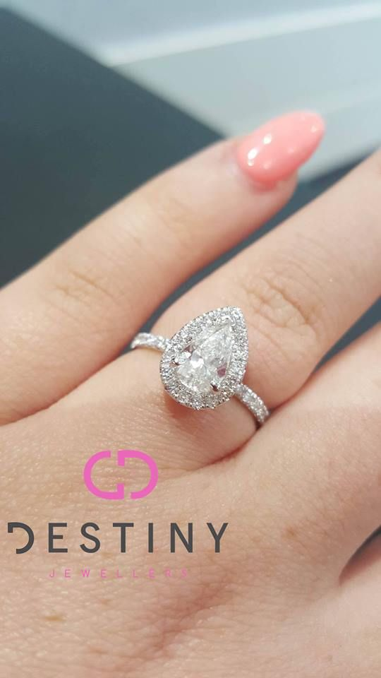 STUNNING!!!!   Amazing Pear Shape Halo Diamond Ring!!  Let Us Help You Make Her Dream Into A Reality! ... See More