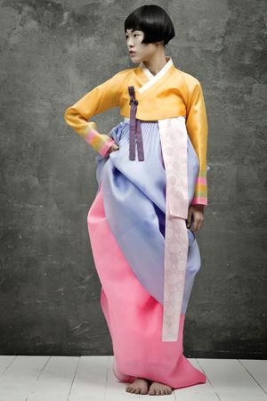 Hanboks of Vogue Korea -- Looks cumbersome but beautiful. Three soft colors work well - wonder how it would look hot pink, bright blue, deep yellow?  Probably not as nice.