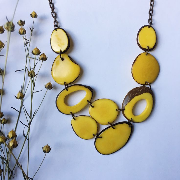 Yellow necklace. Tagua nut jewelry. Ethical Jewelry. Yellow statement Necklace. Sela Designs. Tagua necklace. Charity jewelry. by SelaDesigns on Etsy https://www.etsy.com/listing/477487086/yellow-necklace-tagua-nut-jewelry
