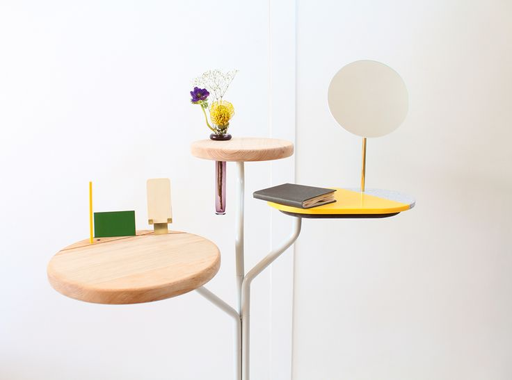 Tree Table, designed by Isabel Quiroga, combining HI-MACS®, wood & stone.