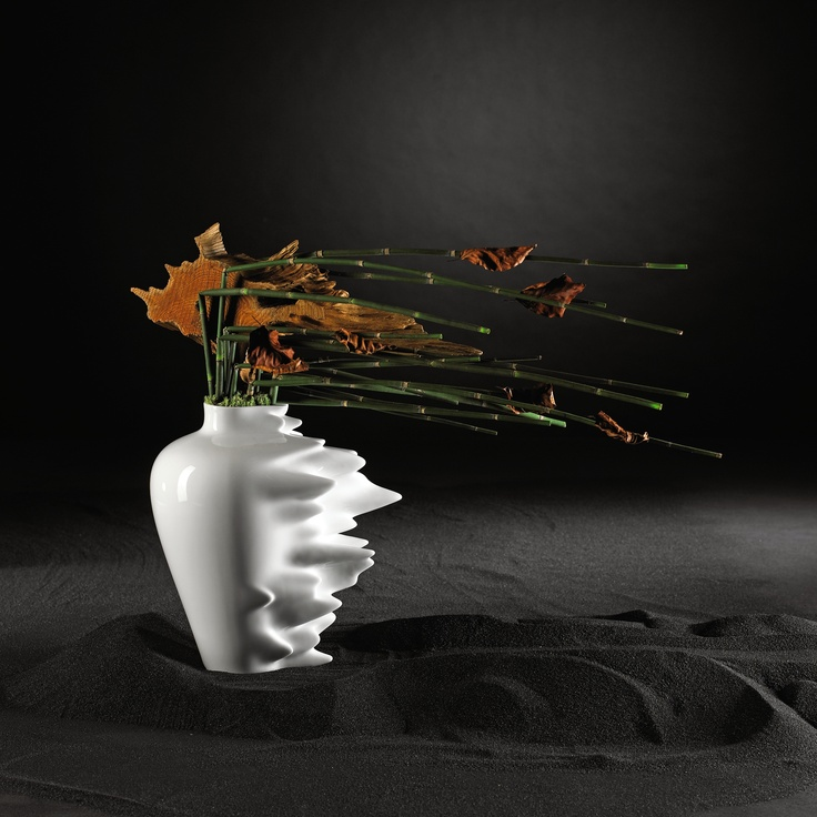 The Fast vase is a modern interpritation of Ming dynasty vases; its dynamic form symbolizing the cultural changes that have been produced by digital technology. It represents the speed at which information is processed, and lost, and the speed at which we live our lives. The Fast vase is made from porcelain and is a beautiful, sculptural piece with or without flowers.