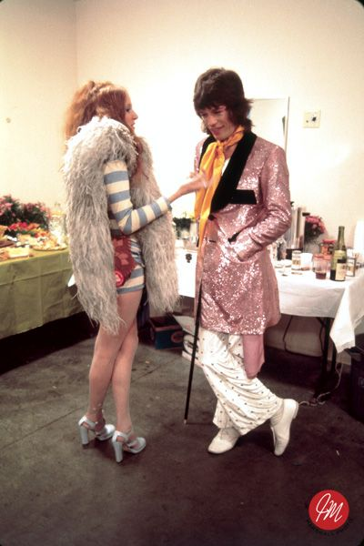 mick jagger y rose taylor 70s rock star glam fashion pink smoking jacket men's pants fur shorts heels women vintage style fashion