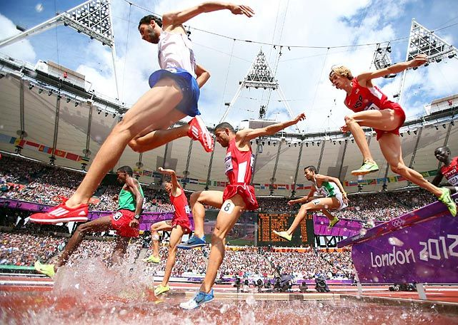 In his heat of the 3,000-meter steeplechase, Evan Jager of the U.S. (headband) showed he'll be in the hunt for a medal, taking second in 8:16.61, just .38 of a second behind France's Mahiedine Mekhissi-Benabbad (blue shorts). #london2012