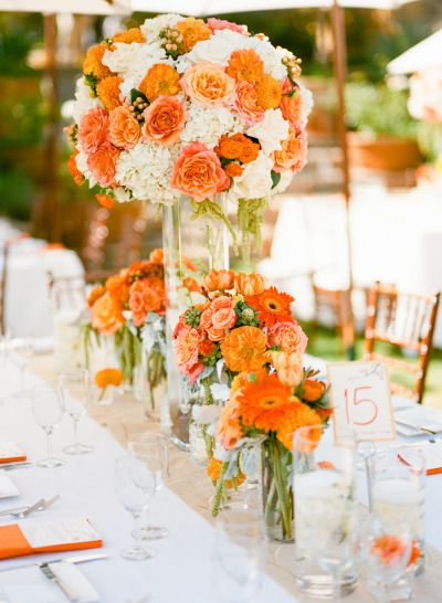 Beautiful wedding flowers: http://www.stylemepretty.com/2014/11/08/bright-orange-malibu-wedding/ | Photography: Erin Hearts Court - http://www.erinheartscourt.com/