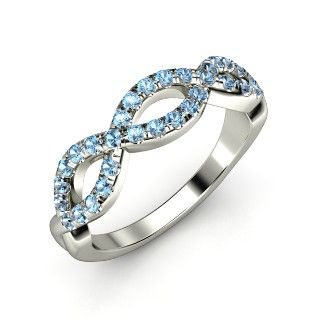 Our newest arrival! The Brilliant Infinity Twist Ring customized in blue topaz and white gold