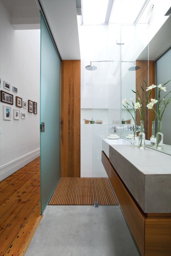 I love the clean lines in this bathroom, and the space saving door along the narrow hallway is well designed.