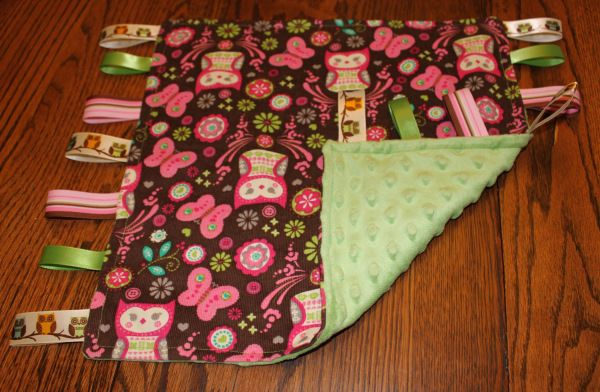 How to make a tag blanket. Step by step instructions. Cute brown, pink and green with owl fabric.