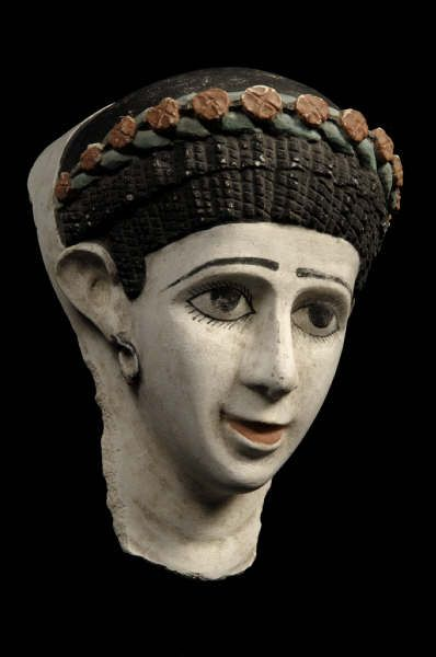 Plaster funerary mask of a woman. Roman Period. 100-200 A.D. | The Barakat Gallery