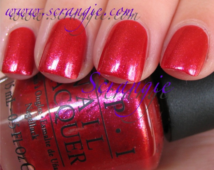 OPI Animal-istic- really interesting red; coral-like with several colors of iridescent color-shifting shimmer. Sometimes it looks tomato red, sometimes cool pink-red and sometimes orangey-coral red.