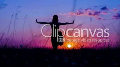 Shot of a young woman silhouette practicing yoga tree pose at nature during sunset. Shot in RAW format. HD Stock Footage Clip. Medium shot. 2016-01-24, RUSSIAN FEDERATION.