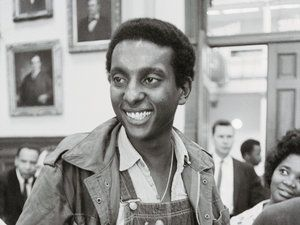 """Stokely Carmichael, chairman of the Student Nonviolent Coordinating Committee, speaks to reporters in Atlanta, May 1966.  His use of the phrase """"black power"""" at a rally in Mississippi grabbed the nation's attention.""""We have to stop being ashamed of being Black!"""" was the first point in a four-part manifesto he often used in his speeches. BLACK, Carmichael told his audiences, WAS SURVIVOR-STRONG.  IT WAS RESOURCEFUL.  AND BEAUTIFUL...Stokely Carmichael's legacy is the very notion of BLACK…"""