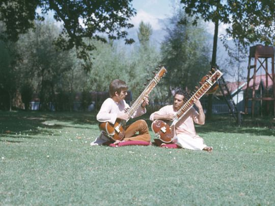 George Harrison and Ravi Shankar play the sitar