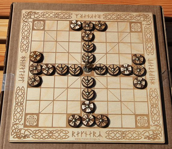 Tafl (Hnefatafl) Vikings Board Game, Kings Table, Scandinavian Game, Vikings Chess Light board Meterial: wood Board size: 295х295х8 mm Game pieces: 25 pieces + 1 bronze figure Handmade, Made in Russia History: Tafl games are a family of ancient Germanic and Celtic strategy board games played on a checkered or latticed gameboard with two armies of uneven numbers, representing variants of an early Scandinavian board game called tafl or hnefatafl in contemporary literature.