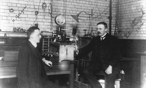 Rutherford and Geiger:Hans Geiger was the German inventor of the Geiger counter, which detects radiation. He is shown here in a laboratory at Manchester with Ernest Rutherford (right), the New Zealand scientist who split the atom. In the 1940s Ernest Marsden, a former student of Rutherford and colleague of Geiger, initiated a search for uranium in New Zealand.
