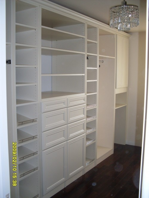 Walk-in closet but with some closed sections - the less-used stuff often gets too dusty in my all-open closet