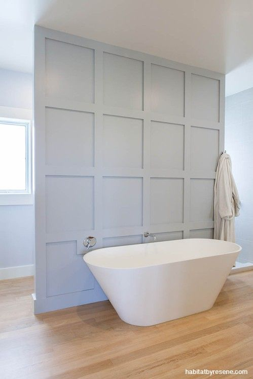 This dreamy ensuite was built with a partition wall of large board and batten squares painted in Resene Silver Chalice, separating the bathtub from the shower and toilet to create a sanctuary-like presence. To finish, they painted the walls in Resene Powder Blue with Resene Half Bianca for the trims.