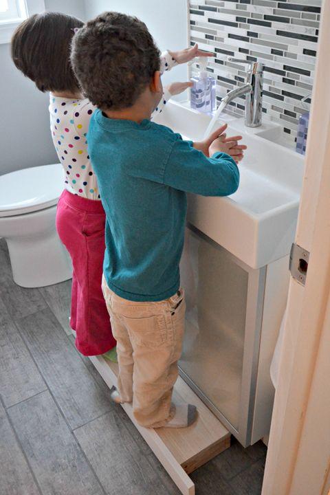 A great modern bathroom update featuring a farmhouse sink glass tile backsplash porcelain woodgrain tiles and a built-in vanity step stool for kids. & Best 25+ Kids step stools ideas on Pinterest | Kids stool 3 step ... islam-shia.org