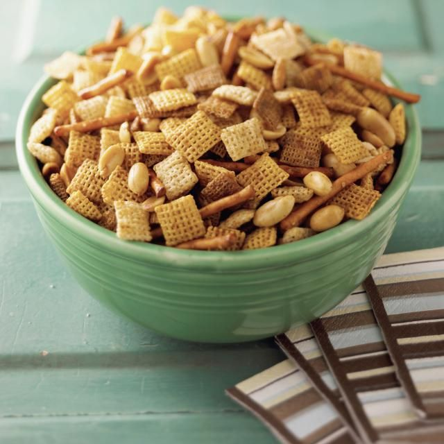 This recipe for Caramel Chex Mix features cereal, nuts, and pretzels covered with a sweet and crunchy baked caramel coating.