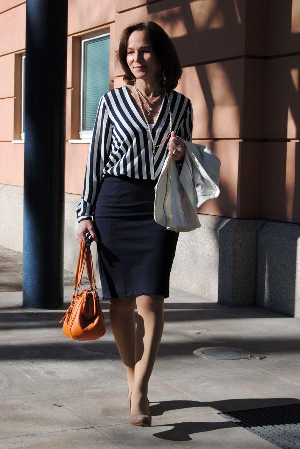 Like everything -- straight skirt slightly above knee, long sleeves -- love bag color.