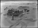 Removing Nobbys wreck. Salvage workers on Nobby's Beach, Newcastle, N.S.W. Photograph by Sam Hood, October 1950. Find more detailed information about this image:  http://acms.sl.nsw.gov.au/item/itemDetailPaged.aspx?itemID=31906#  From the collection of the State Library of New South Wales:  www.sl.nsw.gov.au