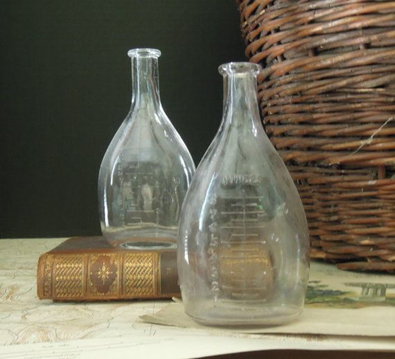 Cool product and I love the use of the old book, basket and print in staging.  Vintage / Antique Graduated Nursing Bottle / by AloofNewfWhimsy