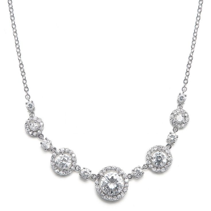 This bridal necklace has CZ rounds with small inlaid stones and is inspired by the circle of love necklace, perfect for wedding day jewelry.